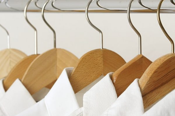 White shirts on wooden hangers